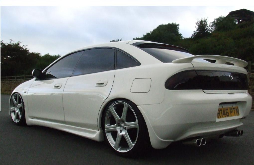 mazda 323 technical specifications and fuel economy. Black Bedroom Furniture Sets. Home Design Ideas